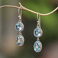 Blue topaz dangle earrings, 'Radiant Eternity' - Blue Topaz and Sterling Silver Dangle Earrings from Bali
