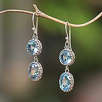 Blue topaz dangle earrings, 'Radiant Eternity' - Blue Topaz and Sterling Silver Dangle Earrings from Bali