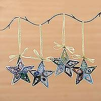 Recycled paper ornaments, 'Dangling Starlight' (set of 4) - Artisan Crafted Recycled Magazine Ornaments Set of 4