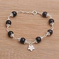 Onyx charm bracelet, 'Frangipani Eclipse' - Onyx and Sterling Silver Frangipani Charm Bracelet