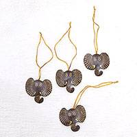 Coconut shell ornaments, 'Elephant with Golden Tusks' (set of 4) - Set of 4 Handmade Coconut Shell Elephant Ornaments