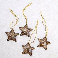 Coconut shell ornaments, 'Bright Lights in the Sky' (set of 4) - Set of 4 Handmade Brown Coconut Shell Star Ornaments