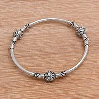 Sterling silver bangle bracelet, 'Bali Celebration' - Sterling Silver Bangle Bracelet from Bali