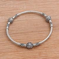 Sterling silver bangle bracelet, 'Bali Celebration' - Sterling Silver Bangle Bracelet from Bali