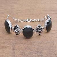 Onyx and garnet link bracelet, 'Enchanting Beauty' - Onyx and Garnet Sterling Silver Link Bracelet from Bali