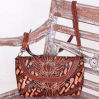Batik leather sling, 'Parang Garden' - Leather Floral Parang Sling with Interior Pockets
