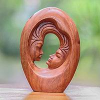 Wood sculpture, 'Love Portal' - Romantic Hand-Carved Faces of Couple Suar Wood Sculpture
