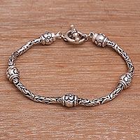 Sterling silver station bracelet, 'Floral Borobudur' - Floral Sterling Silver Station Bracelet from Bali