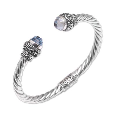 Blue topaz cuff bracelet, 'Flourish in Blue' - Balinese Blue Topaz and Sterling Silver Cuff Bracelet