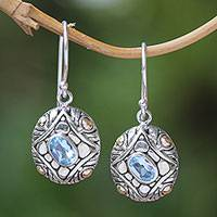 Gold-accented blue topaz dangle earrings, 'Jungle Diamonds' - Sterling Silver Blue Topaz Dangle Earrings with Gold Accents