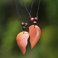 Wood pendant necklaces, 'Shared Heart' (Pair) - Matching Heart Halves Wood Pendant Necklaces (Pair)