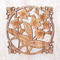 Wood relief panel, 'Bali Plumeria' - Hand-Carved Floral Suar Wood Relief Panel from Bali