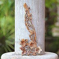 Wood relief panel, 'Frangipani Flourish' - Hand Carved Floral Suar Wood Wall Relief Panel