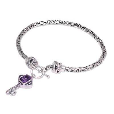 Amethyst charm bracelet, 'Beauty Unlocked' - Handcrafted Amethyst and Sterling Silver Key Charm Bracelet