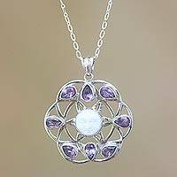 Amethyst pendant necklace, 'Matahari' - Sun Face Cow Bone Amethyst Sterling Silver Pendant Necklace