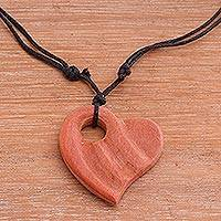 Wood pendant necklace, 'Wavy Heart' - Sawo Wood Heart-Shaped Pendant Necklace from Bali
