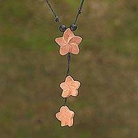 Wood pendant necklace, 'Three Jepuns' - Sawo Wood Frangipani Flower Pendant Necklace from Bali