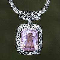 Blue topaz pendant necklace, 'Buddha Curl Memories' - Buddha Curl Motif Amethyst Necklace from Bali