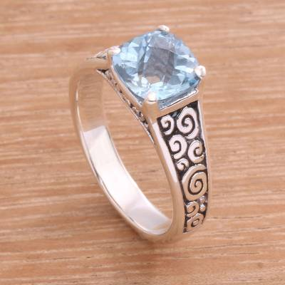 Blue topaz solitaire ring, 'Sparkling Heavens' - Blue Topaz and Sterling Silver Swirl Motif Solitaire Ring