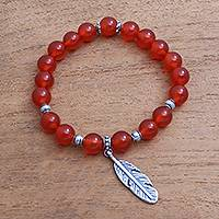 Carnelian beaded stretch bracelet, 'Elegant Feather' - Carnelian Feather Beaded Stretch Bracelet from Bali