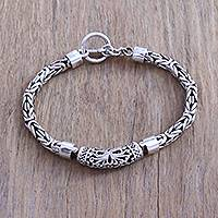 Sterling silver pendant bracelet, 'Borobudur Sunrise' - Sterling Silver Swirl Motif Pendant Bracelet from Bali