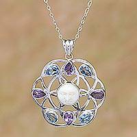 Blue topaz and amethyst pendant necklace, 'Matahari' - Blue Topaz and Amethyst Sun Face Pendant Necklace from Bali