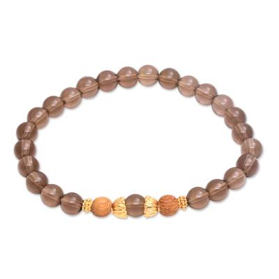 Gold accent smoky quartz beaded stretch bracelet, 'Batuan Tune' - Smoky Quartz Beaded Stretch Bracelet with Wood Accents