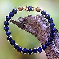 Lapis lazuli beaded stretch bracelet, 'Batuan Tune' - Lapis Lazuli and Gold Plated Silver Beaded Stretch Bracelet