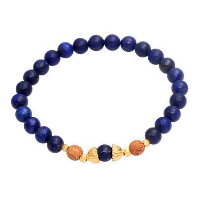 Gold accented lapis lazuli beaded stretch bracelet, 'Batuan Tune' - Gold Accented Lapis Lazuli Beaded Stretch Bracelet from Bali