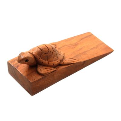 Wood door stopper, 'Baby Turtle' - Baby Turtle Suar Wood Door Stopper from Bali