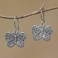 Sterling silver dangle earrings, 'Curling Wings' - Openwork Sterling Silver Butterfly Dangle Earrings from Bali