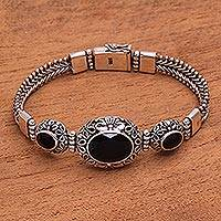 Onyx pendant bracelet, 'Garden Glow' - Floral Black Onyx Pendant Bracelet from Bali