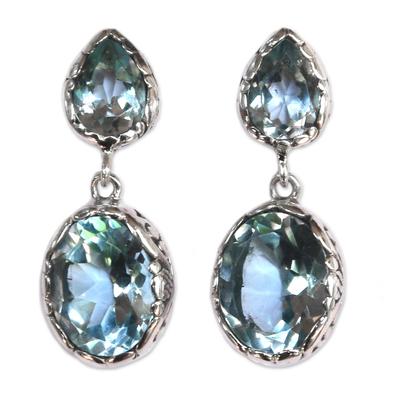 Blue topaz dangle earrings, 'Vibrant Sky' - Bali Sterling Silver Faceted Blue Topaz Oval Dangle Earrings