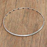 Sterling silver bangle bracelet, 'Chihuahua World' - Paw Print Sterling Silver Bangle Bracelet from Bali