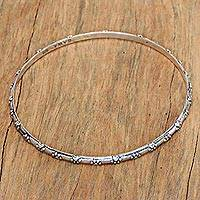 Sterling silver bangle bracelet, 'Puppy World' - Sterling Silver Bangle Bracelet with Paw Print Motifs