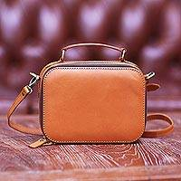 Leather cosmetic bag, 'Hidden Lurik' - Handmade Leather Sling and Handle Cosmetic Bag from Java