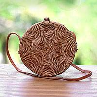 Ate grass shoulder bag, 'Woven Sun' - Hand Woven Ate Grass Circular Shoulder Bag from Bali