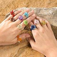 Glass beaded stretch rings, 'Javanese Flora' (set of 10) - Floral Glass Beaded Cocktail Stretch Rings (Set of 10)