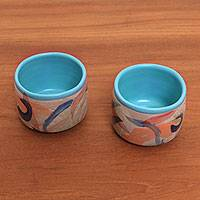 Ceramic teacups, 'Blue Eden' (pair) - Hand-Painted Ceramic Teacups from Java (Pair)