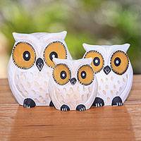 Wood sculptures, 'Snow Owl Family' (set of 3) - Hand-Carved Set of Three Snow Owl Albesia Wood Sculptures