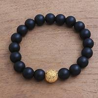 Gold accented onyx beaded stretch bracelet, 'Om Light' - Gold Plated Om Onx Beaded Stretch Bracelet from Bali