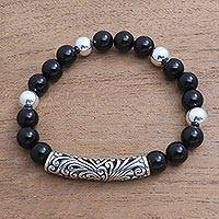 Onyx beaded stretch bracelet, 'Gerhana Arch' - Onyx Beaded Stretch Pendant Bracelet from Bali