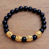 Men's gold accented onyx beaded stretch bracelet, 'Batur Heritage' - Men's Gold Accented Onyx Beaded Stretch Bracelet from Bali