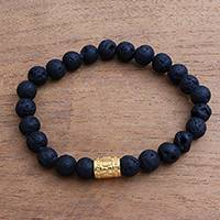 Men's gold accent lava stone beaded stretch bracelet, 'Batur Pebbles' - Men's Gold Accent Lava Stone Beaded Stretch Bracelet