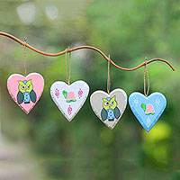 Wood ornaments, 'Loving Times' (set of 4) - Hand-Painted Heart-Shaped Ornaments from Bali (Set of 4)