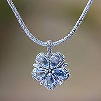 Blue topaz pendant necklace, 'Bougainvillea Flower' - Floral Blue Topaz and Sterling Silver Pendant Necklace