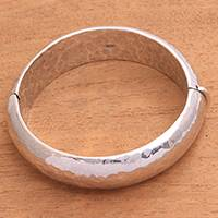 Sterling silver bangle bracelet, 'Texture of Fortune' - Hammered Sterling Silver Bangle Bracelet from Bali
