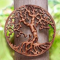 Wood relief panel, 'Trunyan Mystery' - Trunyan Tree Hand Carved Circular Wood Relief Wall Panel