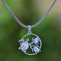 Blue topaz pendant necklace, 'Sea Turtle Family' - Blue Topaz Sea Turtle Pendant Necklace from Bali