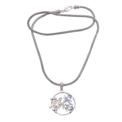 Blue topaz pendant necklace, 'Sea Turtle Family' - Blue Topaz Sea Turtle Pendant Necklace from Bali